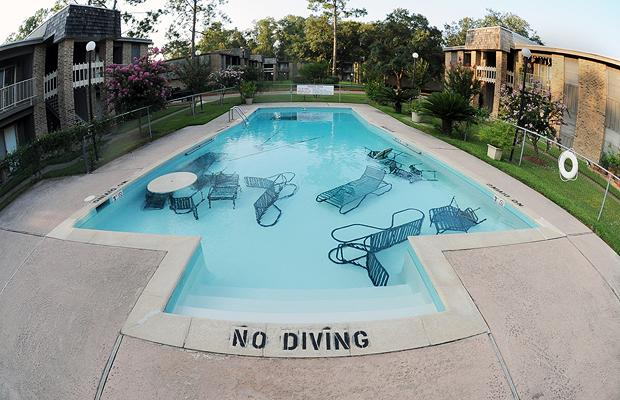 pool with patio furniture sunk to bottom